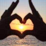 Ibiza sunset hand heart